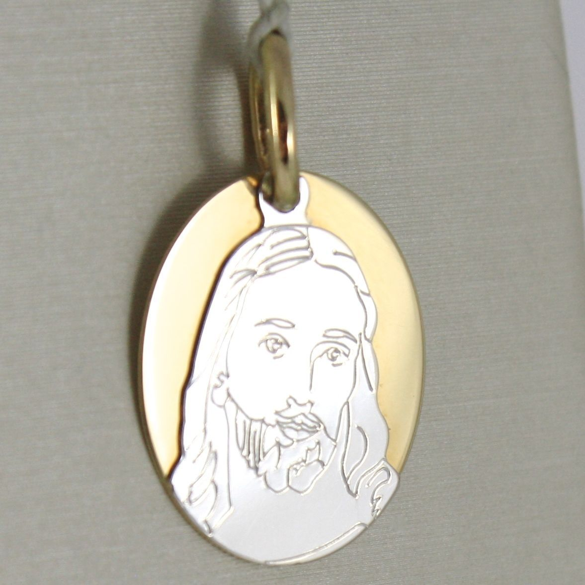 PENDANT MEDAL YELLOW GOLD AND WHITE 750 18K OVAL, WITH FACE OF CHRIST