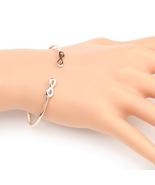 UE- Stylish Rose Tone Designer Bangle Bracelet With Contemporary Infinit... - $12.99