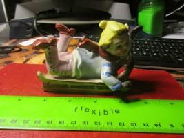 Occupied Japan Child on Sled Figure - $19.99