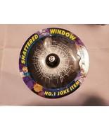 EIGHTBALL AND FOOTBALL IN BROKEN GLASS WINDOW 7 inches diameter - $9.85