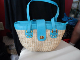 cream woven handbag with teal trim and bright floral lining - $12.00