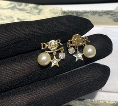 AUTH Christian Dior 2019 DIO(R)EVOLUTION Pearl Crystal Star Dangle Earrings Gold image 5