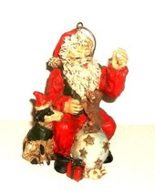 GLASS SANTA AND DOGS ORNAMENT - $11.00