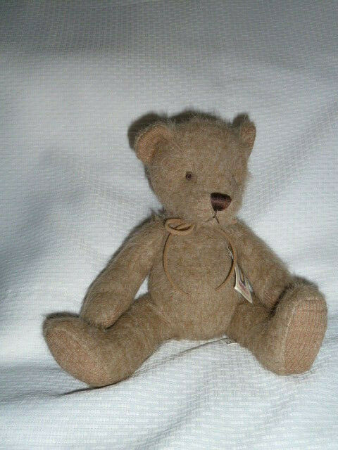 "Primary image for MANHATTAN TOY BEAR Plush Stuffed Animal 2004 Tan leather tie Ribbed Paws 9"" NWT"