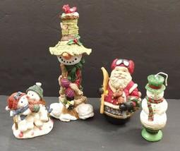 Vintage Lot Of 4 Christmas Figurines Santa Snowmen Resin & Wax  - $12.00