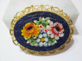 MICROMOSAIC BLUE WITH GOLD TONE METAL CURLICUE SETTING ROSES FLOWERS PIN  - $29.00