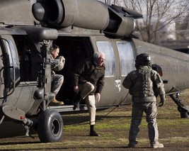 Senator Bernie Sanders exits US Army helicopter in Afghanistan Photo Print - $6.16+
