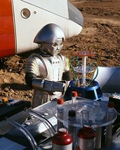 Felix Silla in TWiki outside space craft attending to computer Buck Rogers in - $69.99