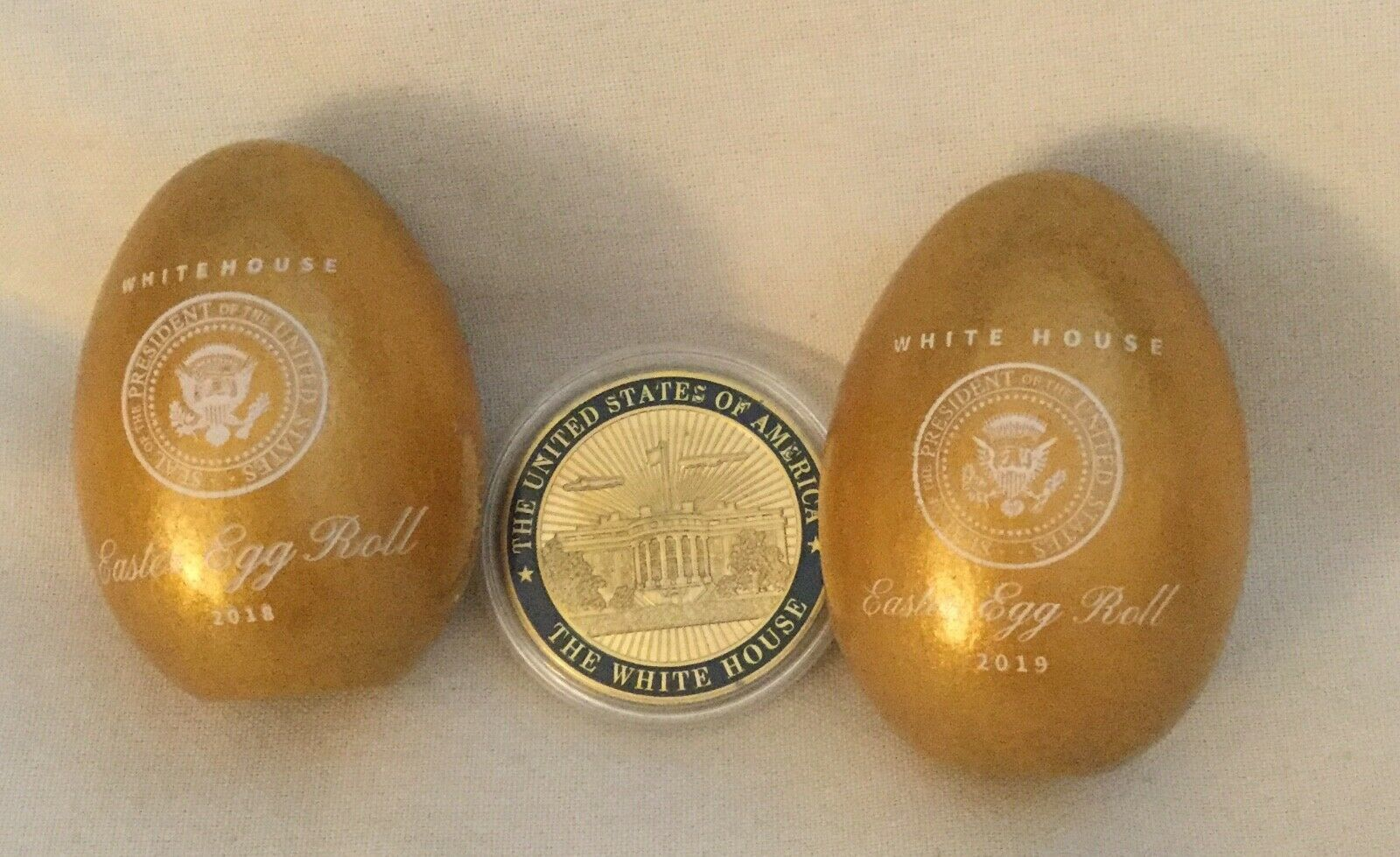 Primary image for 3 TRUMP = 2018 + 2019 GOLD EASTER EGGS (2) + WHITE HOUSE CHALLENGE COIN MAGA EGG