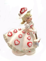 "An item in the Collectibles category: 1950s Relpo A-809 Valentine Girl with Hearts 7"" Vase"