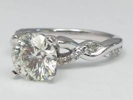 Forever Brilliant Moissanite Center in a Petite Twisted Pave Diamond Eng... - $1,150.00