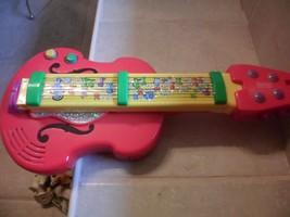 "Mattel Fisher Price 2-in-1 Bach 'n Rock Musical Guitar/Violin, 20"" L - $9.19"