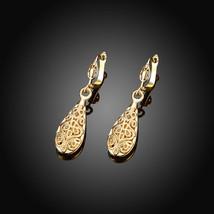 AVENTURA Laser Cut Filigree Snap Closure Fashion Hoop Earrings in 18K Go... - $8.81
