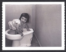 Antique Vintage Photograph Adorable Little Girl Climbing on Disconnected... - $5.35