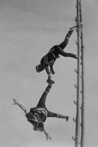 Two Tokyo Firefighters display acrobatic skill on very high bamboo ladders - Art - $19.99+