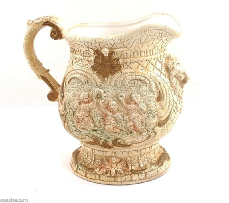 Ceramic 5.5-in Antique Look Pitcher with Cherubs and Lions Head Hi-Relief