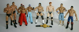 Lot of 9 WWE 2010 used Action Figures and 1 Belt by Mattel Inc. - $49.49
