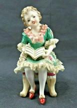 Vintage Japan porcelain reading Girl on chair figurine - $20.00