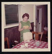 Vintage Photograph Woman With Pocketbook Standing in Retro Kitchen - $6.93