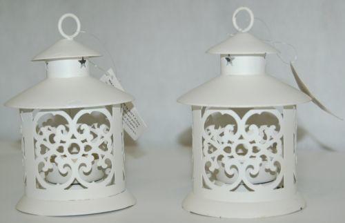 Creamy White Color Candle Lanterns Two Piece Set Cut Out Designs Along Sides