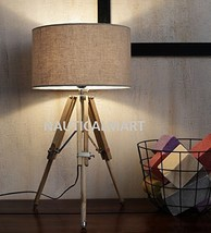 NAUTICALMART BEAUTIFUL DESINER WOOD AND BEIGE COLOR TRIPOD TABLE LAMP - $155.82