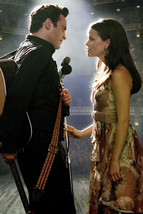 Joaquin Phoenix as Johnny Cash Reese Witherspoon as June Carter on stage in Walk - $23.99