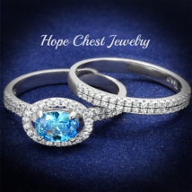 HCJ 1 CT. STERLING SILVER OVAL AQUAMARINE CZ ENGAGEMENT WEDDING RING SET... - $43.49