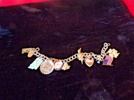 """Vintage Silver 7"""" charm bracelet with 10 charms - $34.65"""