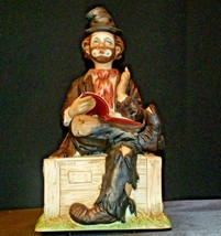 Porcelain Clown with Bisque finish resting on a Bench AA-191925 Collectible
