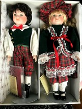 Dynasty Doll Collection set of 2 Carole & Noel Christmas Porcelain Dolls... - $49.49