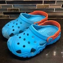 Ionic crocs turquoise orange rubber sandals - $15.84
