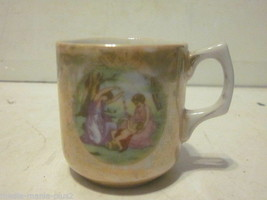 VINTAGE ORANGE LUSTREWARE SMALL TEA CUP WOMEN PLAYING WITH CHILD DESIGN - $9.99