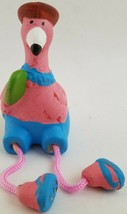 Ceramic Flamingo Figurines with Dangly Legs, Select Skirt Color - $3.49