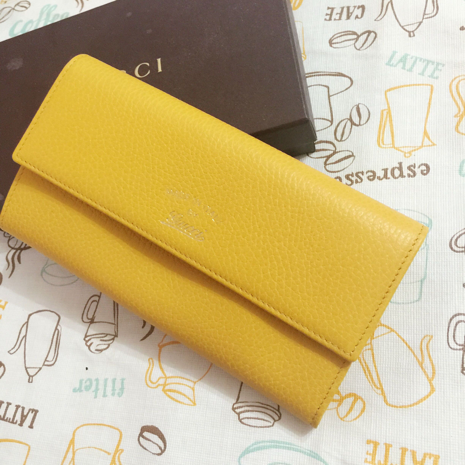 98b9a59be NWT Gucci Yellow Swing Leather Continental and 50 similar items
