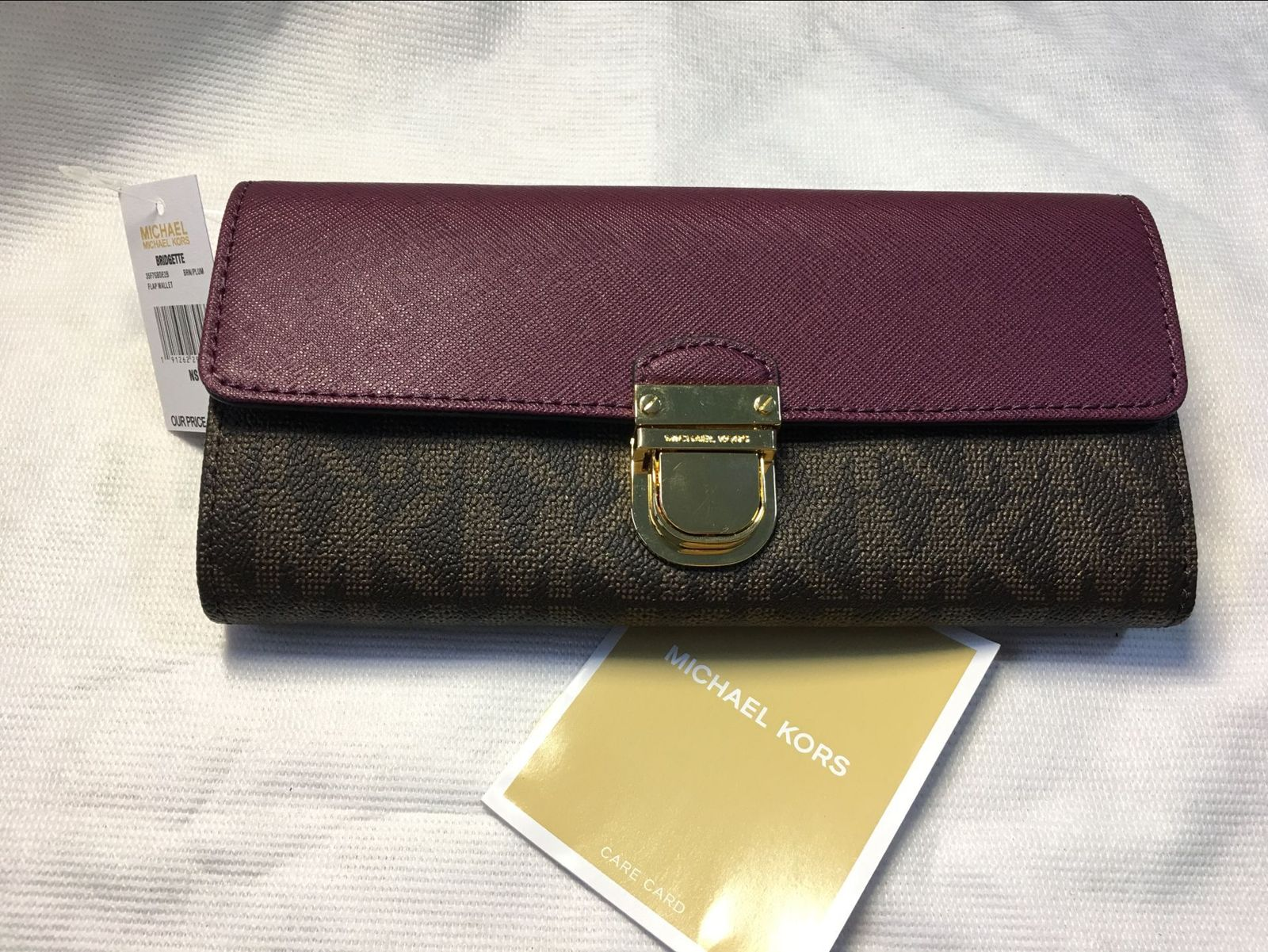 3fa72a1d6546 Authentic Michael Kors Signature PVC and Leather Bridgette Flap Wallet  BRN/PLUM
