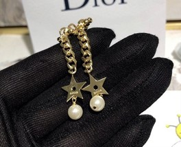 Authentic Christian Dior 2019 CC LOGO CHAIN STAR DANGLE TRIBALE EARRING  image 8