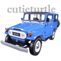 Motormax Toyota FJ 40 Land Cruiser with White Top 1:24 Diecast Car 79323... - $53.88