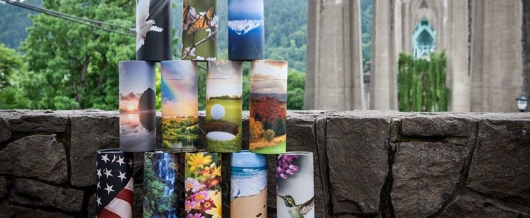 image of cylindrical urns with photos on them