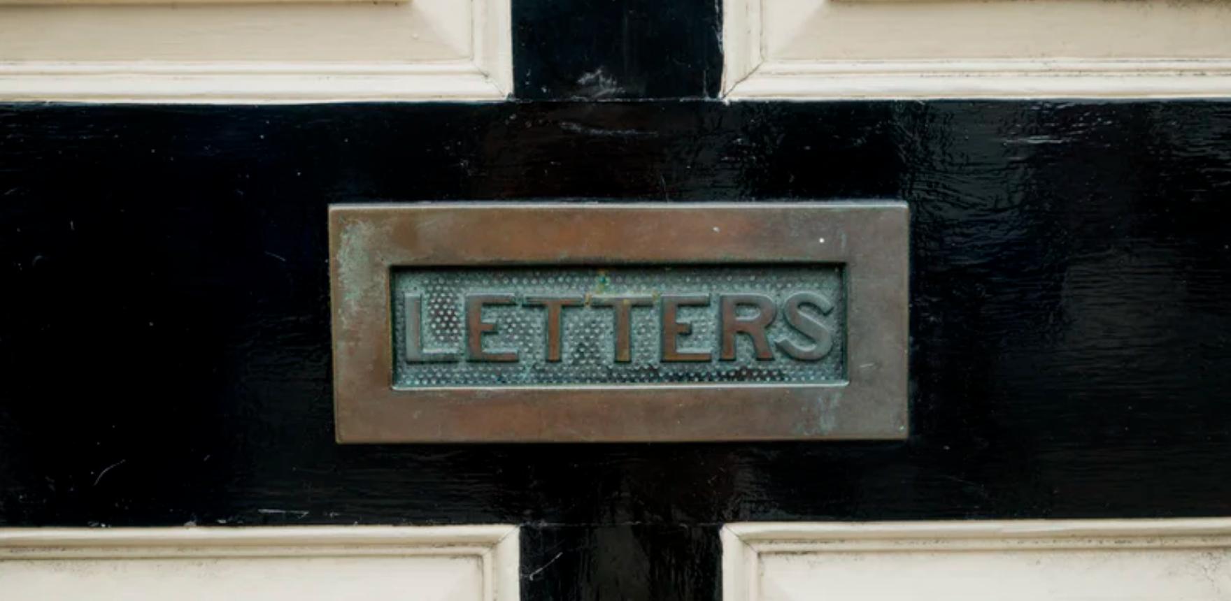 image of letter slot on black door