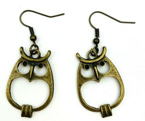 Brass Tone Owl Drop Dangle Pierced Hook Earrings Antiqued Style Metal Owls, an item from the 'Owl Aboard!' hand-picked list