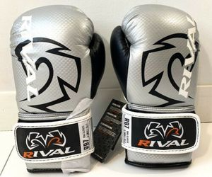 Rival Boxing Bag Gloves RB7 Fitness Hook And Loop New Silver Black Size XS 6oz, an item from the 'Community Picks: Sporty Dad' hand-picked list