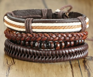 4Pcs/ Set Braided Wrap Leather Bracelets Vintage L Rudder Wood Beads , an item from the 'Fabulous Fall Fashions' hand-picked list