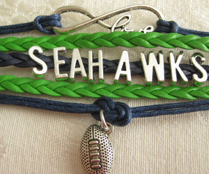 Infinity bracelet Infinity symbol with LOVE, SEAHAWKS, and a football charm in S, an item from the 'Cool Stuff' hand-picked list