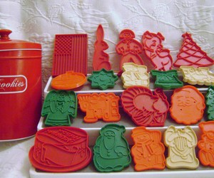 Red  Cookie Tin and Assorted Cookie Cutters, an item from the 'Holiday Cookies & Cooking' hand-picked list