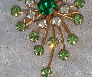 Star burst rhinestone pin brooch timeless swirl emerald green Vintage, an item from the 'Vintage Christmas Bling' hand-picked list