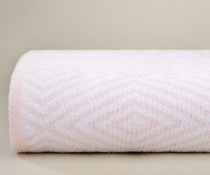 Kashwere Pink and White Diamond Throw Blanket, an item from the 'Girls Night In' hand-picked list