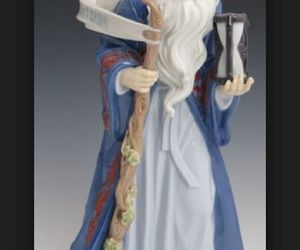 LLADRO 6696 Father Time with Hourglass, an item from the 'Time to Think of Those New Year Resolutions' hand-picked list