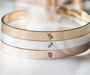 Personalized Zodiac Symbol Bracelet Horoscope Cuff Virgo Leo Gemini Aries Libra, an item from the 'Zodiac Shrine' hand-picked list