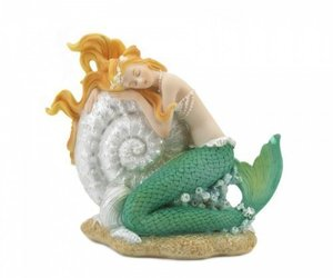 Mermaid Sleeping On Seashell Figurine, an item from the 'Community Picks: Believe in Mystical Magic' hand-picked list