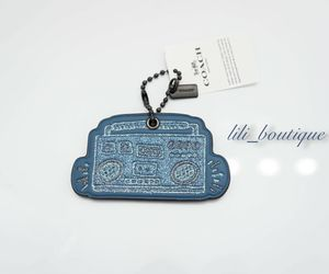 NWT Coach F28599 Keith Haring Glitter Boombox Hangtag Charm Leather Blue Saddle, an item from the 'Keith Haring' hand-picked list